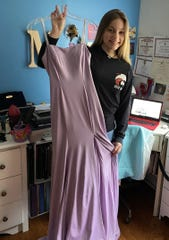 Jackson Memorial High School senior Mackenzie Horvath shows off the dress she bought for her senior prom. But it's among many senior events being threatened due to Coronavirus. She launched a petition drive urging school officials to allow such traditions to occur later.