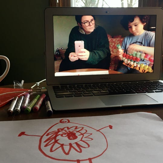Benny Dougherty and his mom, Brennan, wait to connect with Benny's friends on Zoom. Benny has been thinking about the coronavirus and drew a picture of what it might look inside a body.