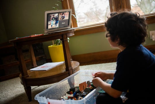 Fremont kindergartener Benny Dougherty, 5, uses Zoom to play with classmates as schools remain closed to slow the spread of COVID-19 on Wednesday, April 1, 2020 at his home in Battle Creek, Mich.