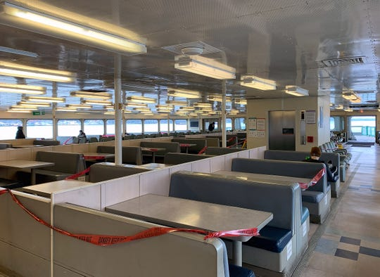 The passenger cabin of the MV Kaleetan was nearly empty Wednesday morning, even after ferry workers herded passengers to one end of the boat and taped off whole sections of seats.