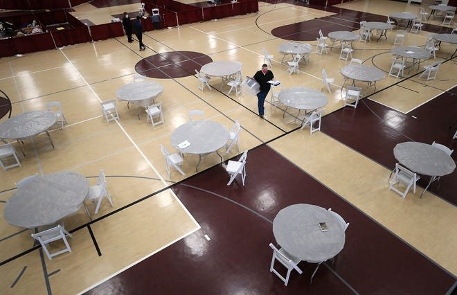 KRM Dayroom Manager Ami Leach walks through the day room seating area of the Kitsap Rescue Mission Shelter at the Kitsap Sun Pavilion on Tuesday, March 31, 2020.