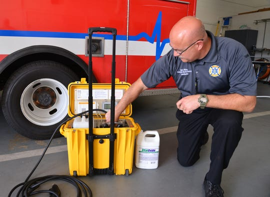 Mark Weiss, Brevard County Fire Rescue infectious control officer, demonstrates an AeroClave disinfecting system used to decontaminate ambulances after possible COVID-19 emergency calls.