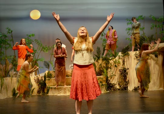 """Kristina Day, cast in the lead role as Ti Moune, celebrates falling in love in the song """"Waiting for Life to Begin"""" in rehearsals for the Mount Mansfield Union High School Theatre Department production of the musical """"Once on This Island."""""""