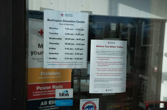 Signs along the Burlington Donation Center on April 1, 2020 instruct donors of the precautions they must take prior to giving blood.