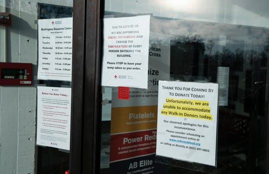 Signs along the door of the American Red Cross's Burlington Donation Center on April 1, 2020 instruct donors on necessary precautions to take during the COVID-19 pandemic.