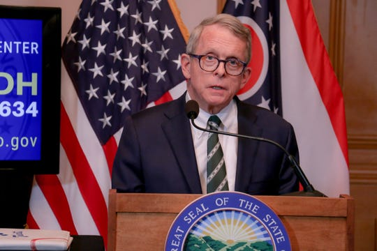 Ohio Gov. Mike DeWine gives an update about the state's response to the novel coronavirus on Tuesday, March 31, 2020.