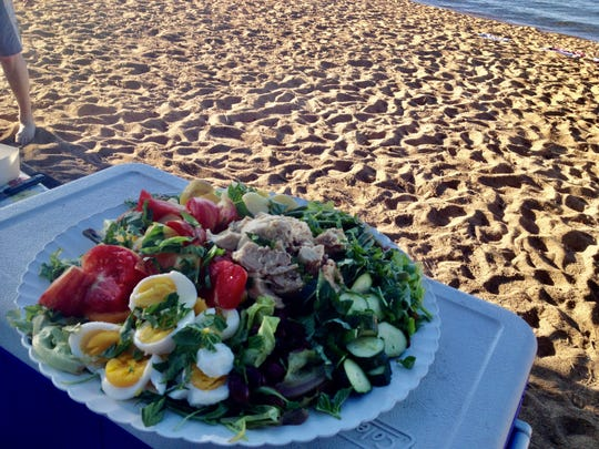 We'll eat niçoise salad on the beach again some day.