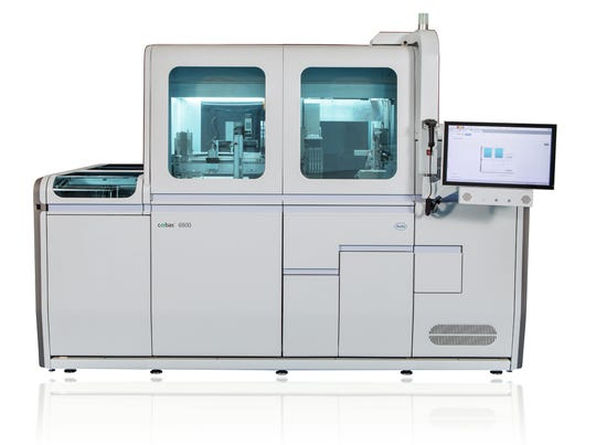 In February, UC Health ordered a molecular testing machine like this one pictured from Roche Diagnostics Corp. But officials had to get U.S. Sen. Rob Portman, R-Ohio, to get the red tape cut and the machine released to the hospital to do testing for the novel coronavirus in the Cincinnati area.