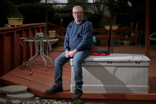 Scott McBurnie, who has been without work since March 15 after being laid off as a server, poses for a portrait, Wednesday, April 1, 2020, at his home in Fairfield, Ohio. McBurnie, 58, was working at First Watch in Liberty Township, which provided steady income and health insurance.