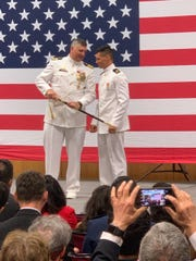 Matt Molinari, right, is awarded a sword during a Rutgers University Naval Reserve Officers Training Corps Unit ceremony.