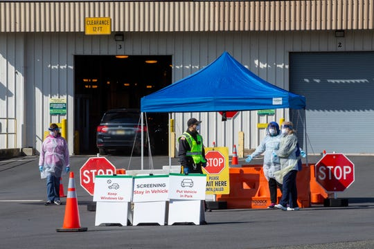 Middlesex County officials open a drive-thru COVID-19 testing site at the NJ Motor Vehicle Commission Kilmer Vehicle Inspection Center in Edison, NJ Wednesday, April 1, 2020. The site will be open Monday, Wednesday and Friday from 10 am to 2 pm by appointment only.