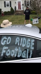 New Ridge head football coach Andy West was welcomed with a drive by from his players Tuesday afternoon