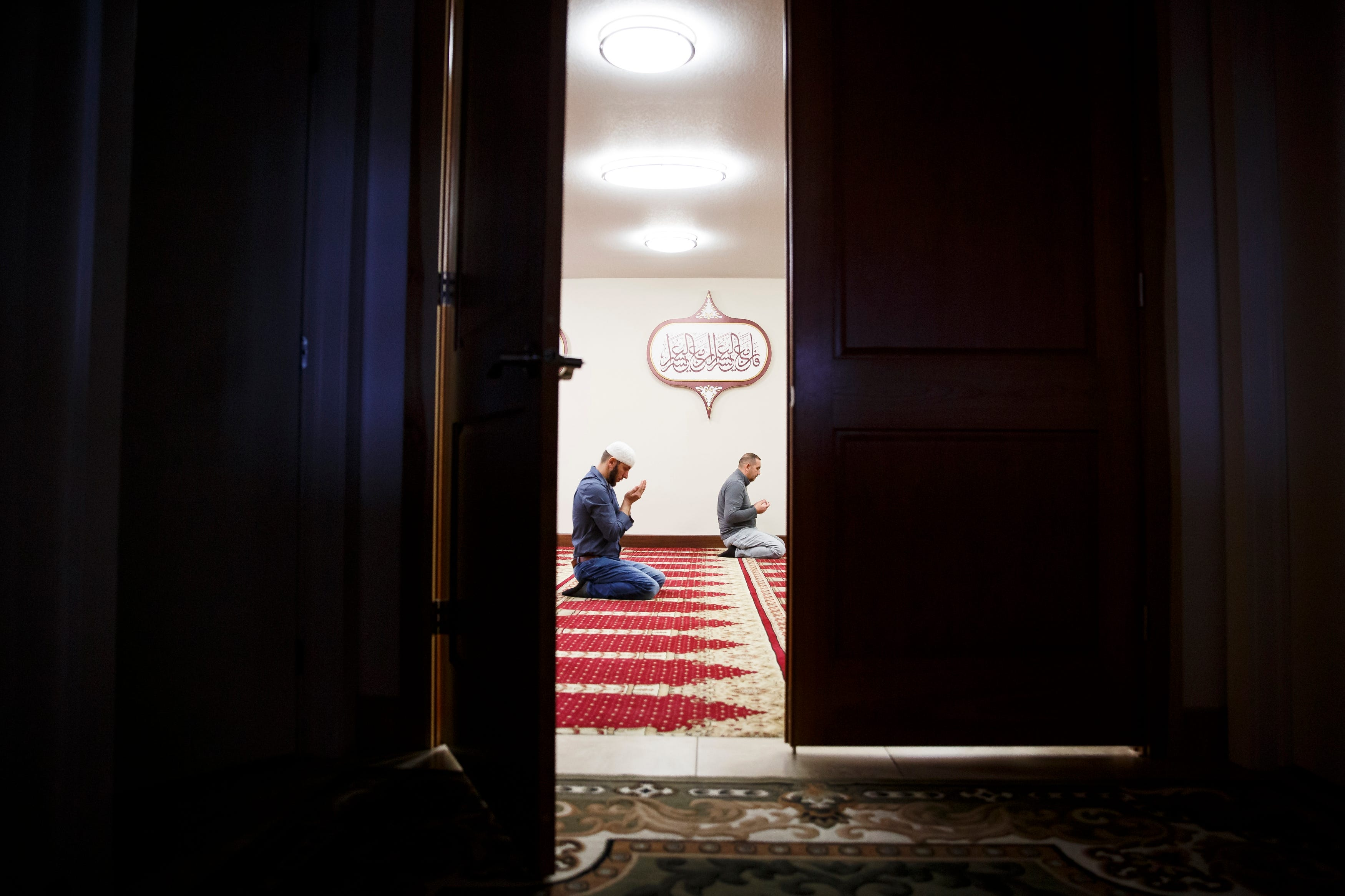 """Meho Music prays during Jumah Prayer at the Islamic and Cultural Center Bosniak in Granger on Friday, March 27, 2020. The Friday prayer usually fills the room, but to comply with social-distancing rules, the ICC limited the prayer to just members of the board. """"We have to respect the blessings we have,"""" Imam Nermin Spahić said, adding that, right now, """"This is the best option for us."""""""