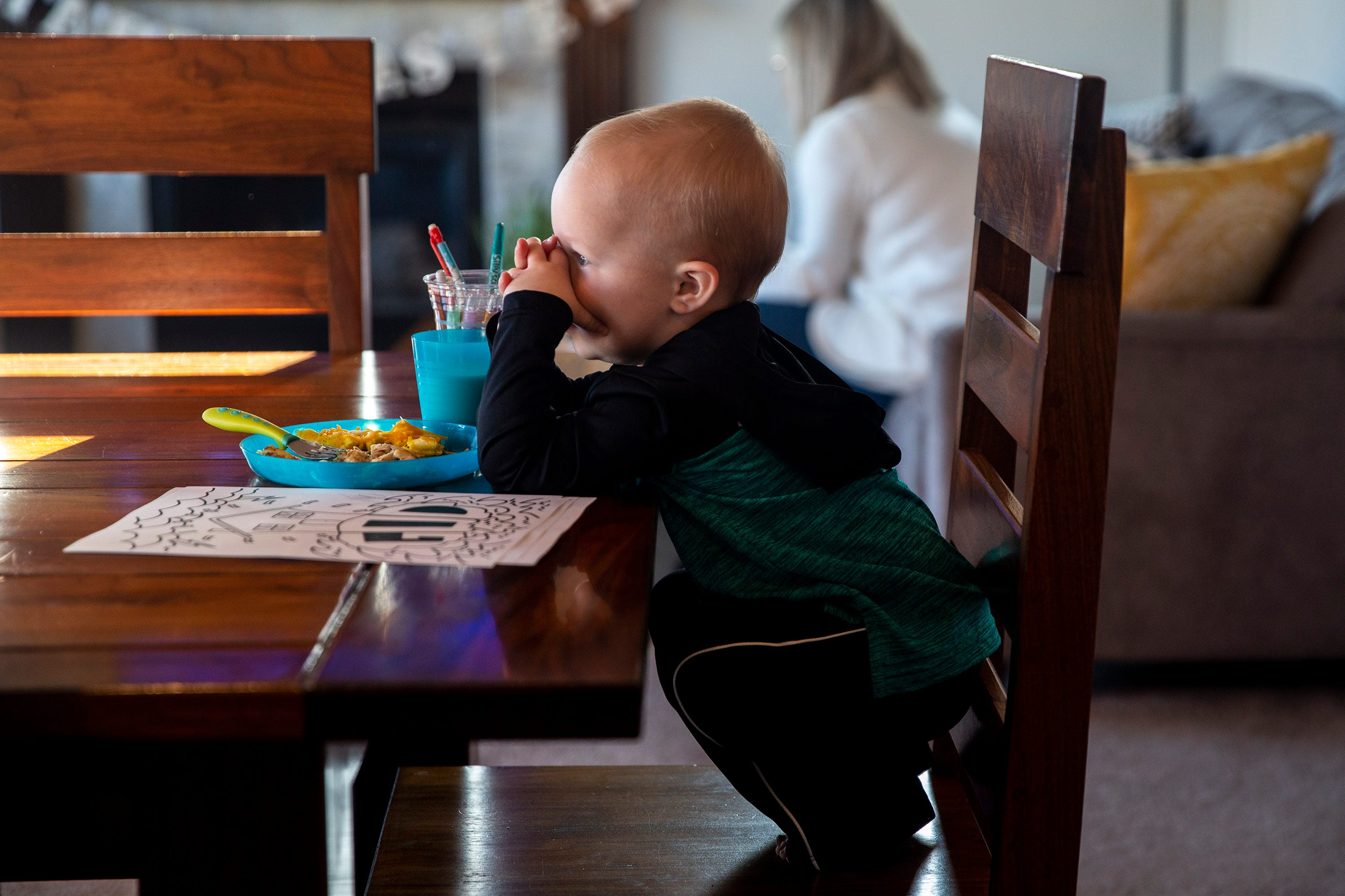Two-year-old Hudson prays with his family as they watch the livestream of Lutheran Church of Hope's Sunday morning service on March 29, 2020, from the family's home in Waukee.