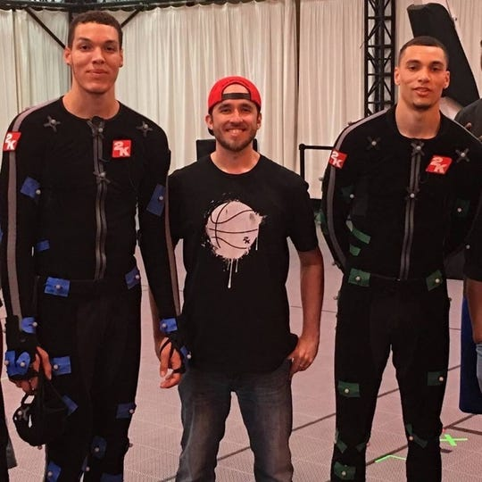 NBA players Aaron Gordon, left, and Zach LaVine, right, pose for a photo with Iowan Zach Timmerman.