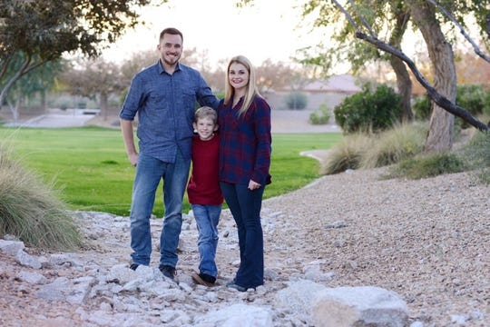 Zach Timmerman, son Mason and wife Mary.