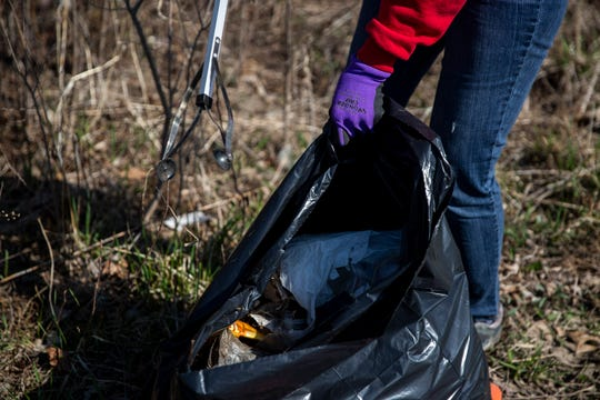 Des Moines City Councilwomen Connie Boesen picks up trash along East 33rd Street near Hubble Avenue on Wednesday, April 1, 2020, in Des Moines. Boesen started the project as a way to give back while still keeping a social distance.
