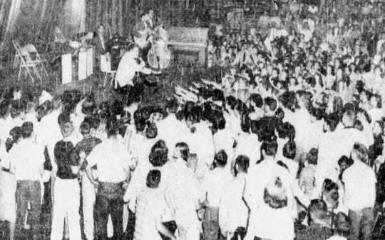 """From May 1956: Fans reach out to touch Elvis Presley, billed as America's """"only atomic powered singer"""" during his concert May 22, 1956, at Veterans Memorial Auditorium in Des Moines."""