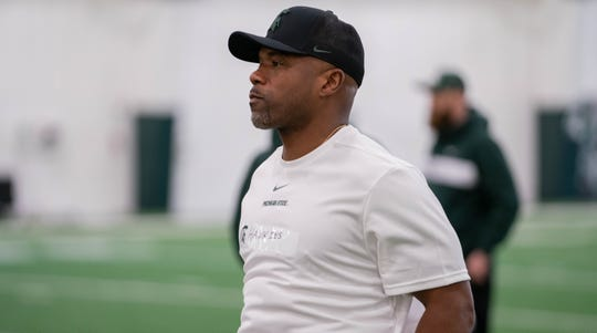 New Michigan State football wide receivers coach Courtney Hawkins was a two-time All-Big Ten first-team selection during his Spartan career from 1998-91.