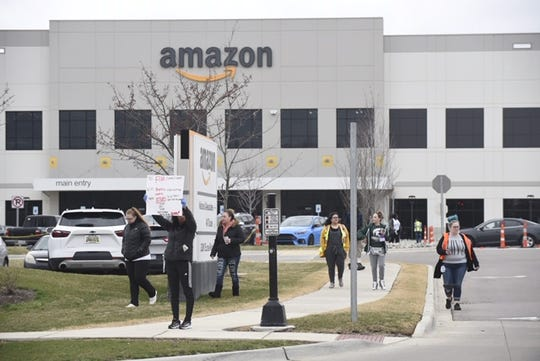 Workers walk off the job at the Amazon Fulfillment Center midday in Romulus Wednesday , April 1, 2020.