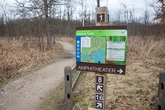 A sign directs people to the nature trails at Kensington Metropark, in Milford, April 1, 2020.