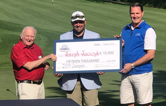 Joe Juszczyk collects $15,000 for winning a mini-tour event in Minnesota in 2019.