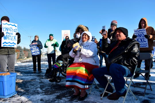 Opponents of the Keystone XL oil pipeline from Canada demonstrate Oct. 29, 2019, in sub-freezing temperatures in Billings, Mont.