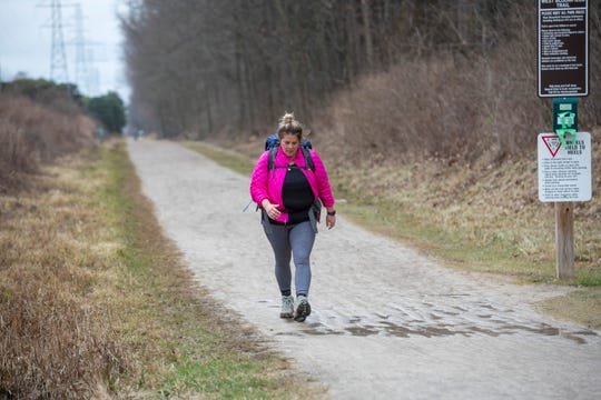 Denise Shaheen of St. Clair Shores trains for a hike at the West Bloomfield Trail and Nature Preserve, in West Bloomfield.