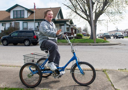 Ryan Green, 15, rides down the sidewalk near his home the day after his trike was stolen and found Wednesday afternoon April 1, 2020. Green has Down's Syndrome and since school has been out due to the COVID-19 pandemic he has been riding every day. After his mother, Soni Stinson,  wrote about the theft on social media numerous people reached out to help and one anonymous person purchased a new trike for Green which will arrive on April 7th. Green's trike was returned Tuesday evening after being found about 20 blocks from their home.