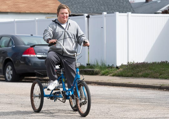 Ryan Green, 15, rides down the street near his home the day after his trike was stolen and found Wednesday afternoon April 1, 2020. Green has Down's Syndrome and since school has been out due to the COVID-19 pandemic he has been riding every day. After his mother, Soni Stinson,  wrote about the theft on social media numerous people reached out to help and one anonymous person purchased a new trike for Green which will arrive on April 7th. Green's trike was returned Tuesday evening after being found about 20 blocks from their home.