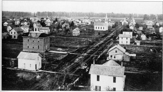 The aerial view looks north in Helena with the old school in the foreground at the left.