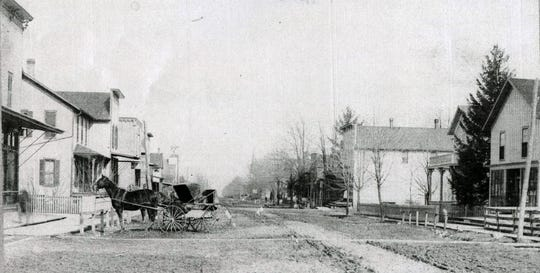 This is Helena in about 1900 looking east on Main Street, which is Ohio 6 today, from around the railroad tracks.