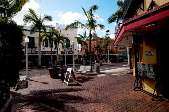 Scenes from downtown Fort Myers at the lunch hour on Sunday,  March 29, 2020. Businesses and restaurants are shuttered or are offering take out dining beacause of the coronavirus pandemic.