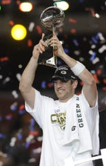 Green Bay Packers quarterback Aaron Rodgers lifts the Lombardi Trophy over his head after winning the Super Bowl against the Pittsburgh Steelers in Super Bowl XLV at Cowboys Stadium in Arlington, Texas, on Sunday, Feb. 6, 2011. USA TODAY NETWORK-Wisconsin