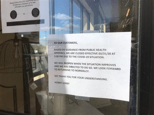 The Rib Mountain Hobby Lobby posted a sign notifying customers it would close on March 31 to comply with guidance from public health officials that it is a non-essential business.