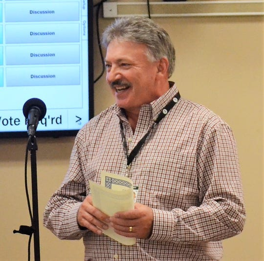 Longtime Oconto County Highway Commissioner Pat Scanlan, who is retiring April 3, thanks the County Board after being recognized at their March 19 meeting.