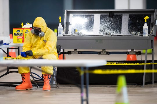 A paramedic prepares to conduct a test for the coronavirus at Greenville Convention Center Wednesday, April 1, 2020. The test site is set up to provide rapid testing for first responders and healthcare providers.