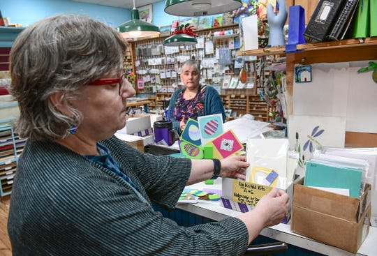 Terri Brooks, left, looks at a packaged craft for making Easter cards near Cindy Huggins at The Mercantile in downtown Pendleton Wednesday.