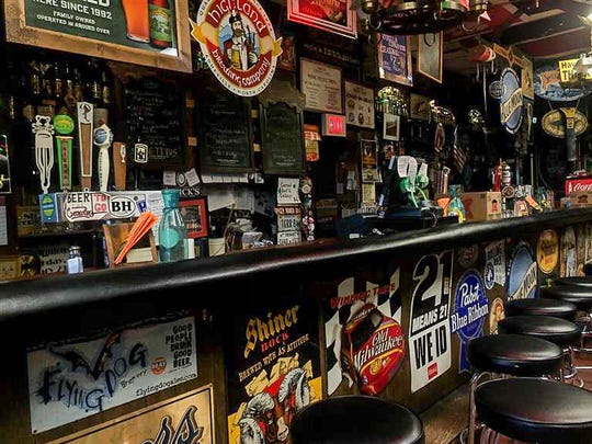 """NIck's Tavern in Clemson until further notice, the only stream of revenue coming from the occasional crowler or keg of craft beer that owner and operator Dale Masi sells. """"It's mainly just to give me something to do,"""" he said in his empty bar Tuesday."""