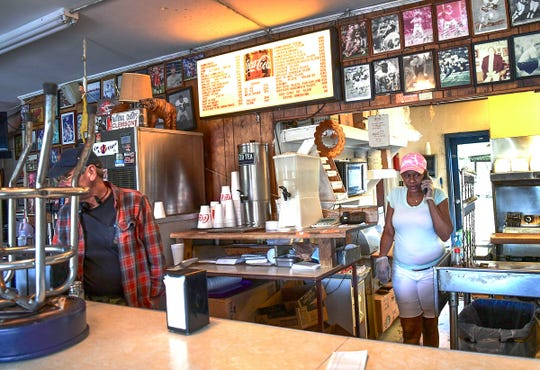 Dee Harris, a cook at Mac's Diner in Clemson, fills a takeout order at the restaurant Wednesday.