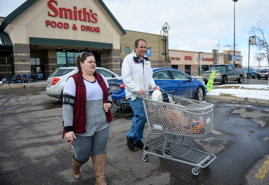 Dan Hazen, a client of Easterseals-Goodwill, finishes his shopping trip at Smith's Grocery Store on Wednesday afternoon with program lead coordinator Amanda Holmes.