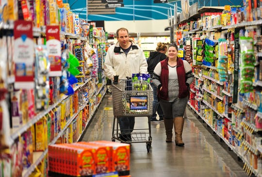 Dan Hazen, a client of Easterseals-Goodwill, shops at Smith's Grocery Store on Wednesday afternoon with program lead coordinator Amanda Holmes.