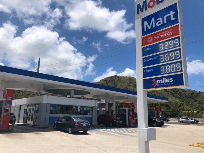 A sign at the Adelup Mobil gas station shows the price of regular gasoline is now $3.30.
