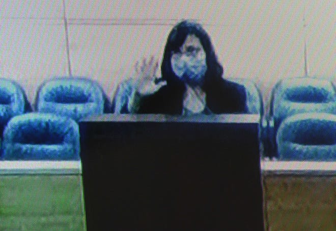 Linda DeNorcey, Department of Public Health and Social Services director, is seen on a video display as she appeared in Superior Court of Guam on April 1, 2020.