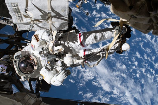 NASA astronaut Andrew Morgan is pictured tethered to the International Space Station while finalizing thermal repairs on the Alpha Magnetic Spectrometer, a dark matter and antimatter detector, during a spacewalk that lasted 6 hours and 16 minutes, Saturday, Jan. 25, 2020.