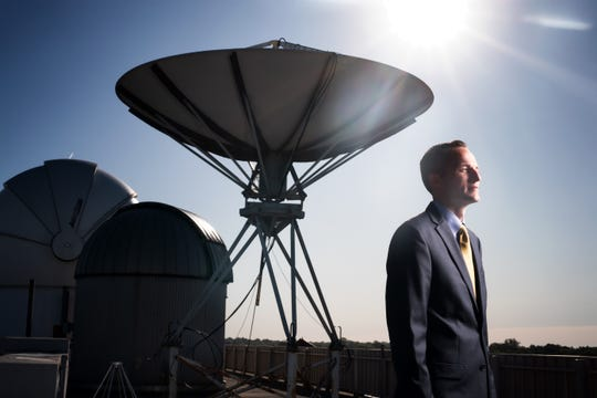 Daniel Newton, University of Iowa Assistant Professor, Henry B. Tippie College of Business poses for a photo, Sept. 26, 2019, on the roof of the Van Allen Hall in Iowa City, Iowa.