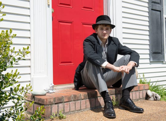 """Chester County senior Gideon McManus wears his costume in front of his home, Wednesday April 1, 2020. McManus would of played Don Lockwood in a high school production, """"Singing in the Rain.""""  This was his final theater production in high school."""
