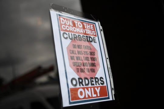 A sign is seen outside Marble City Ale House, which had it's grand opening Feb. 29 on Jack Dance Street off Kingston Pike, as seen Wednesday, April 1, 2020. The bar has had to modify their business because of coronavirus restrictions.