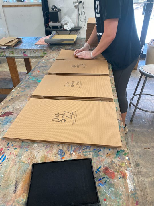 Labeling Art ToGo boxes at Studio 212 on March 26, 2020.