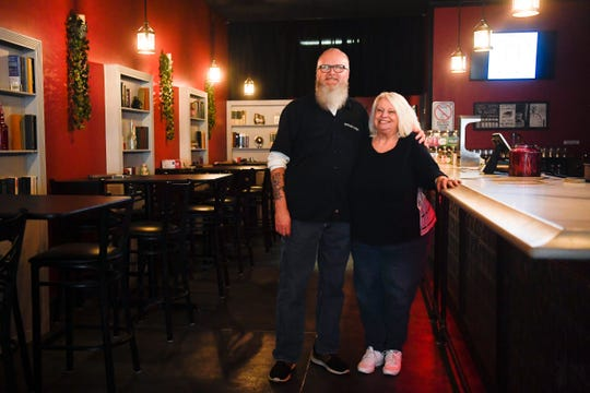 Owners Glenn Cate and wife Karen, pose for a photo in an empty Marble City Ale House, which had it's grand opening Feb. 29, on Jack Dance Street off Kingston Pike, as seen Wednesday, April 1, 2020. The bar has had to modify their business because of coronavirus restrictions.